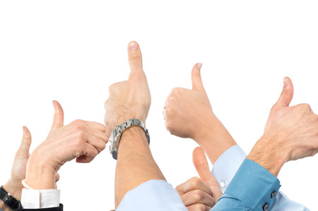 Close Up Of Businesspeoples Hand Gesturing Thumb Up Sign photo