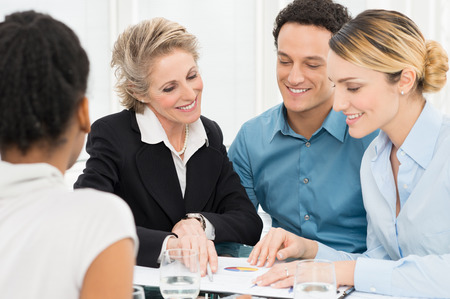 business advisor: Portrait Businesspeople Discussing In Meeting