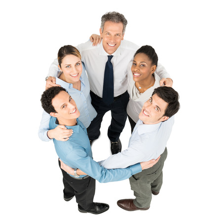 High Angle View Of Happy Businesspeople Making Huddle photo