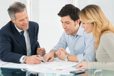 Happy Couple Looking Blueprint About New House