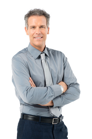 studio portrait: Portrait Of Proud Mature Businessman Looking At Camera Isolated On White Background Stock Photo