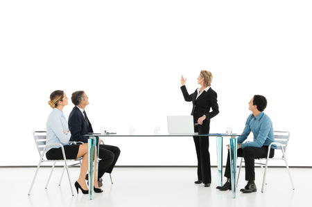 Portrait Of A Mature Businesswoman Giving Presentation photo