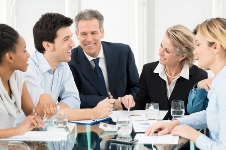 boardroom: Portrait Of Happy Multiracial Businesspeople Discussing In Meeting Stock Photo