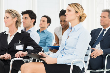 job training: Multiracial Businesspeople Attending A Seminar Together