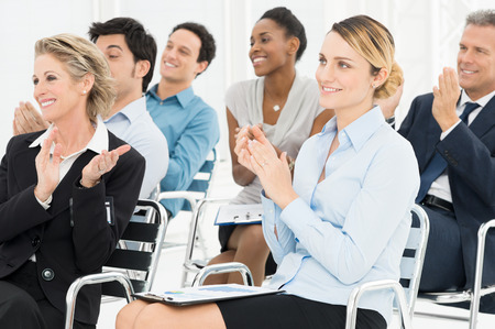 training: Group Of Happy Multiracial Businesspeople Clapping At Seminar