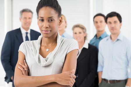 company manager: Confident African Businesswoman In Front Of Office Staff