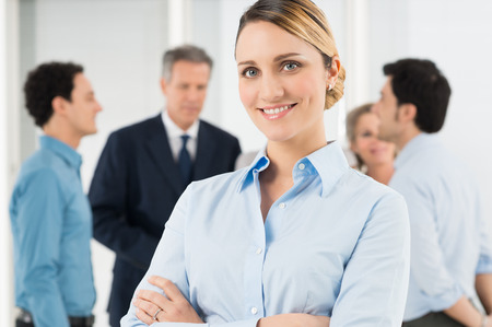 crossed: Portrait Of Beautiful Businesswoman Standing With Arm Crossed