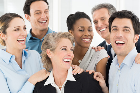 Multi Ethnic Teamwork Laughing And Exult Stock Photo