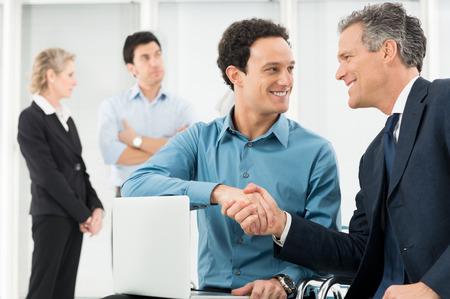 congratulate: Portrait Of Two Businessman In Office