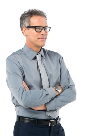 Portrait Of Mature Businessman In Eyeglasses With Arm Crossed Isolated On White Background Stock Photo - 27614196