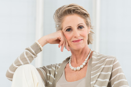 Portrait Of Happy Mature Woman Wearing Necklace photo