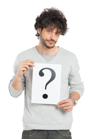 Confused Young Man Showing Question Mark Signboard Isolated On White Background Stock Photo