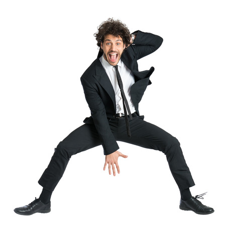 Portrait Of Happy Smiling Man In Suit Jumping Isolated On White Background photo