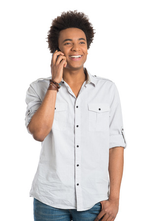 Young Smiling African Man Talking On Cellphone Isolated on White Background photo