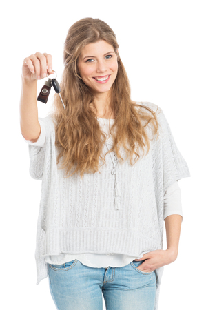 Portrait Of Young Woman Showing Car Key Isolated On White Background photo