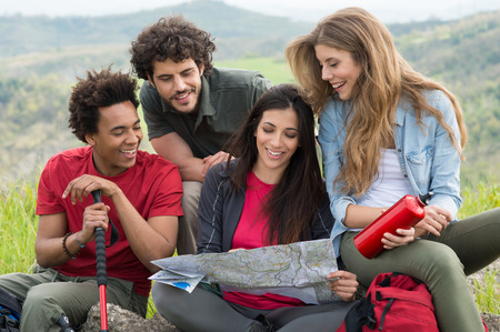 Hikers Looking The Map In Countryside photo