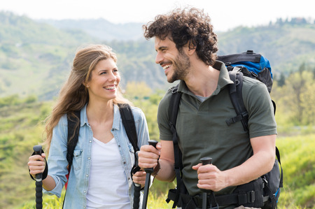 trekking pole: Young Happy Couple Trekking In Countryside