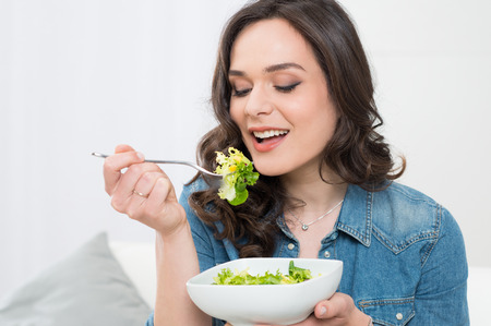 Close-up Of Beautiful Young Woman On A Diet photo