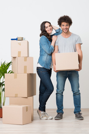 Young Woman Standing Besides Man Holding Cardboard Box photo