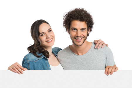 happy couple white background: Young Happy Couple Holding Blank Banner Isolated On  White Background Stock Photo