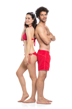 Happy Couple In Red Swimwear Standing Isolated On White Background photo