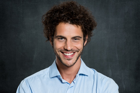 Portrait Of Young Businessman Over Gray Background Фото со стока