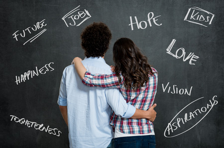 Hope: Young Couple With Arm Around Each Other Hope For a Better Future Over Gray Background