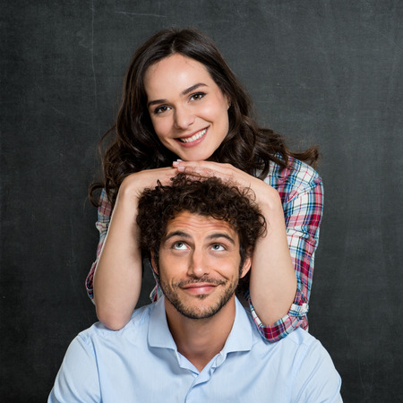 Man Looking At Happy Woman Leaning On His Head photo