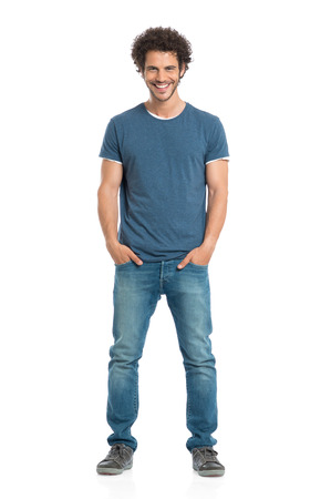 Portrait Of Happy Young Man With Hands In Pocket Standing Isolated On White Background