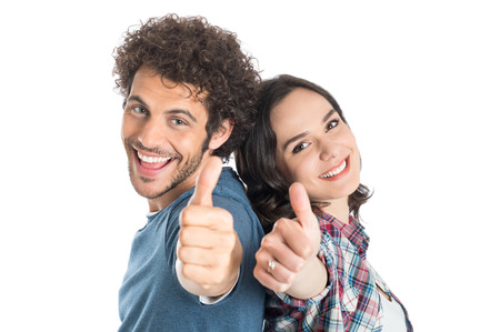 thumb up: Portrait Of Happy Young Couple Showing Thumb Up Isolated White Background