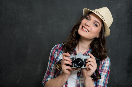 Happy Hipster Girl Holding Vintage Camera Isolated On Gray Background photo