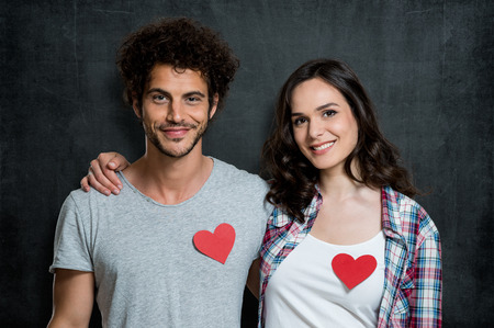 Young Happy Couple With Red Heart Shape photo