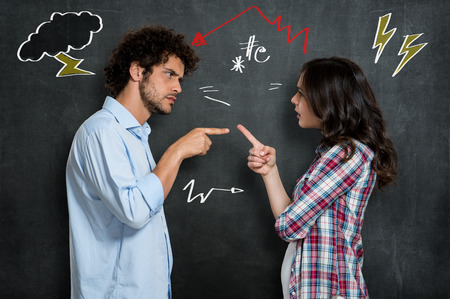fight: Discussion Between Guy And Girl Over Gray Background Stock Photo