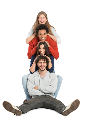 Group Of Multiracial Friends Leaning On Each Other Shoulder Isolated On White Background photo