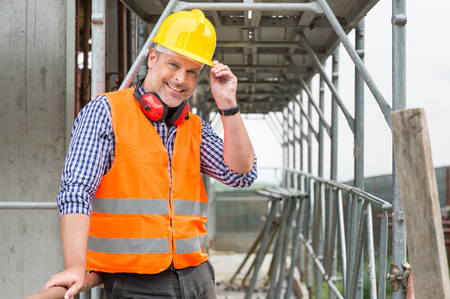 bricklayer: Portrait Of Confident Bricklayer At Construction Site Stock Photo