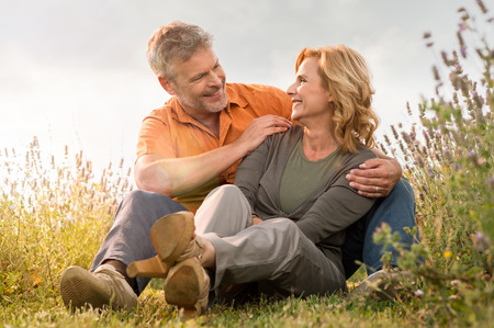 Happy mature couple laughing together outdoor in the park photo