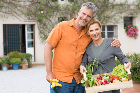 Portrait Of Happy Mature Couple With Vegetable photo
