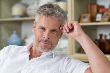 Portrait Of Confident Mature Man Looking At Camera photo