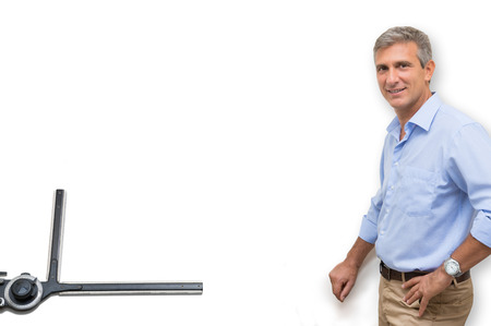Portrait Of Smiling Architect Standing In Front Of Blank Drawing Table photo