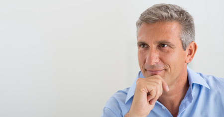 Portrait Of Mature Businessman Thinking About The Project photo