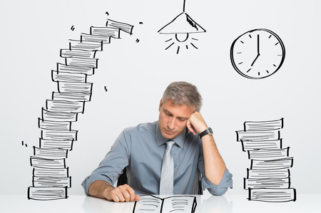 till: Tired Businessman Working and Studying Till Late In Office