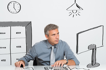 contemplated: Absorbed business man working at computer in office