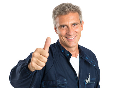 mechanic: Portrait Of Confident Mature Mechanic Gesturing Thumbs Up Sign Isolated On White Backgriund