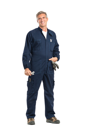 1 mature man: Portrait Of Confident Mature Mechanic With Wrench Looking At Camera Standing Isolated On White Background