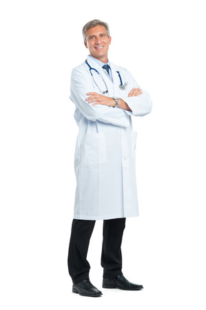 medical doctors: Portrait Of Smiling Mature Doctor With Arm Crossed