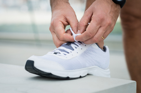 lacing: Closeup Of Male Tying Shoelace On Sneakers