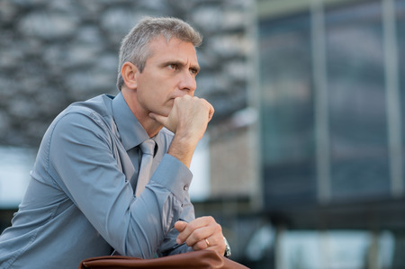 mature men: Closeup Of A Thoughtful Mature Businessman Outdoor Stock Photo