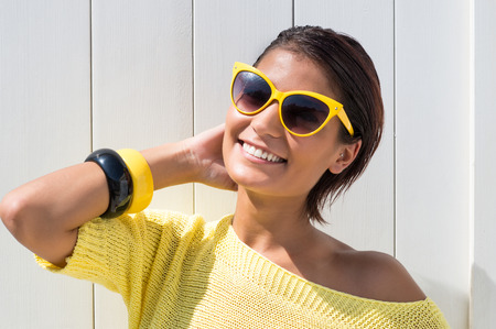 Portrait Of Young Pretty Woman In Casual With Summer Glasses photo