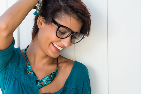 Portrait Of Happy Smiling Young Woman With Eyeglasses