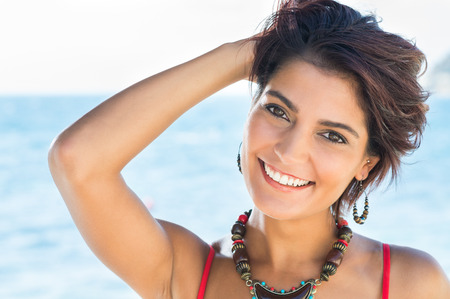 beaches: Portrait Of Happy Beautiful Young Woman In A Summer Day Stock Photo